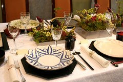 Table design in Japan. A beautiful table design with dishes, glasses and flower arrangements Stock Photography