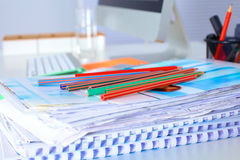 Table designer working space with a computer and paperwork Royalty Free Stock Photography