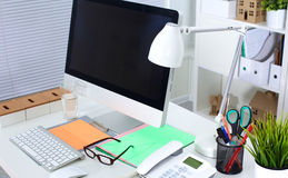 Table designer working space with a computer and paperwork Stock Photo