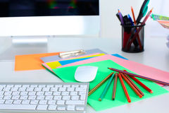 Table designer working space with a computer and paperwork Royalty Free Stock Photos