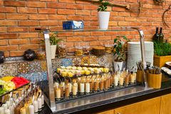 Desserts on the table in the restaurant. Table with desserts and sweet muses in a restaurant royalty free stock photos