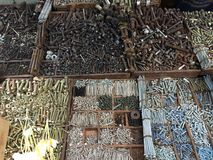 Detail of a tray of iron nails. Table with different types of nails and screws of different materials in a Yangon street market royalty free stock photos