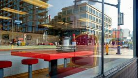 Table at a diner in a downtown city center. An old fashioned diner amid the new fangled designs and buildings and business concepts Royalty Free Stock Photography