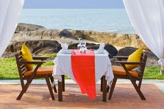 Dinner table beside beach Royalty Free Stock Photography