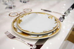 Table with dinner dishes Stock Photos