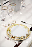 Table with dinner dishes and glasses Stock Photography