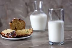 Delicious aromatic cake and a glass of milk on a table with a marbled background. stock photo