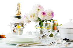 Table with dishes and flowers Royalty Free Stock Images