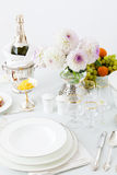 Table with dishes and flowers Royalty Free Stock Image