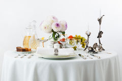 Table with dishes and flowers Royalty Free Stock Photography