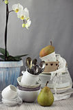 Table with dishes and white orchid Stock Photos