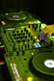 Table for DJ. In the work. Vertical Royalty Free Stock Photo