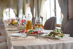 Table with drinks and food for party. Long table served with snacks and food and drinks for event in elegant restaurant stock photography