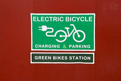 Table `Electric bicycle charging & parking` and `Green bikes station` Royalty Free Stock Photo