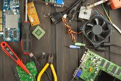 Table electronics repairman. Home computer repair. Desktop clutter electronics repairman. Recycling of multiple computers. Royalty Free Stock Photo