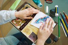 Table with elements for scrapbooking handcraft stock photos
