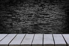 Table empty The background is brick wall Empty top wooden shelves and stone wall background royalty free stock photo