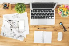 Table with empty gadgets and sketch. Top view of creative designer table with empty gadgets, supplies and architectural sketch. Workplace and engineering concept Royalty Free Stock Photos