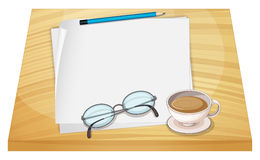 A table with empty papers, a pencil, an eyeglass and a cup of ho Royalty Free Stock Images