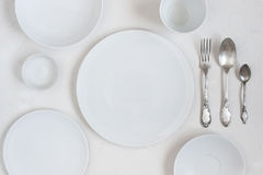 The table with empty white plates Royalty Free Stock Images
