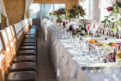 Table for enjoyment. Wedding Birthday Reception Decoration, Chairs, Tables and Flowers Stock Images