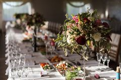 Table for enjoyment. Wedding Birthday Reception Decoration, Chairs, Tables and Flowers Royalty Free Stock Photos