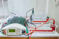 Table with equipment for gel electrophoresis at Biochemical laboratory.  Stock Image