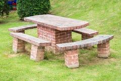 Table et chaises de brique Photographie stock libre de droits