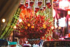 Table for event with flower vases, towels and wine glasses royalty free stock photos