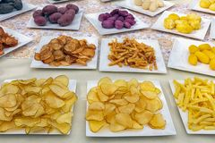 Table with exposure of different potato products Stock Photography