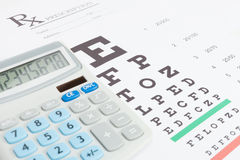 Table for eyesight test and medical prescription form with calcu Stock Photography