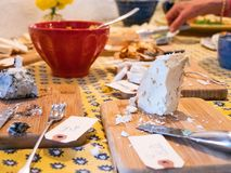 Table filled with cheese platter and food stock photography