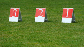 Table with first, second and third places. In green grass Stock Images