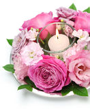 Table flower arrangement with candle Stock Photos