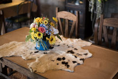 Table flower cow skin Stock Photography