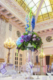 Table with flowers in banquet hall Stock Photo
