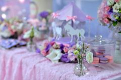 Table with flowers and a dessert Stock Images
