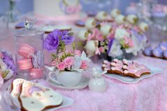 Table with flowers and a dessert Stock Photo