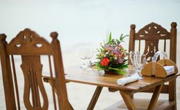 Table with flowers for romantic dinner Royalty Free Stock Images