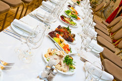 Table with food. Banquet. Table with food. Glasses, plates and forks stock photography