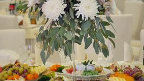 Table with food and bouquet on the wedding stock video footage