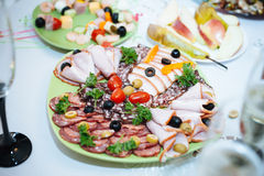 Table with food and drink. Catering table set Stock Images