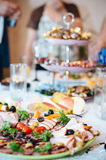 Table with food and drink. Catering table set Royalty Free Stock Photos