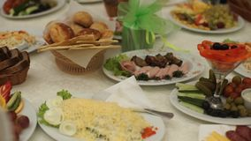 Table with food and drink. Catering table set service with silverware and glass stemware at restaurant before party stock footage