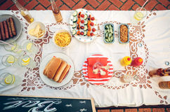 Table with food and drinks in summer party Stock Photo
