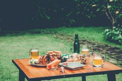 Table Food Graden party enjoying home party on garden home.  royalty free stock photos