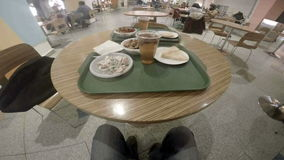 Table with food on green tray in the cafe stock footage