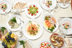 Table with food in restaurant Stock Photos