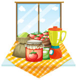 A table with foods near the window Stock Image
