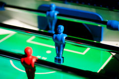 Table football. A game of table football with blue and red players Stock Photo
